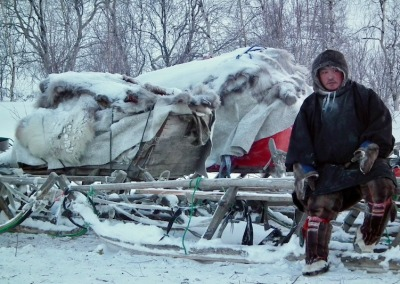 Nomadic Nenets reindeer herder at his camp in the foothills of the Polar Ural Mountains